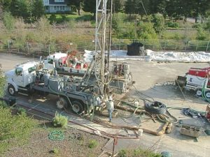 Drill rig and service truck for boring and grouting of vertical pipe loops